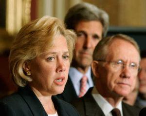 Democratic senator Mary Landrieu speaks alongside Harry Reid and John Kerry in Washington.