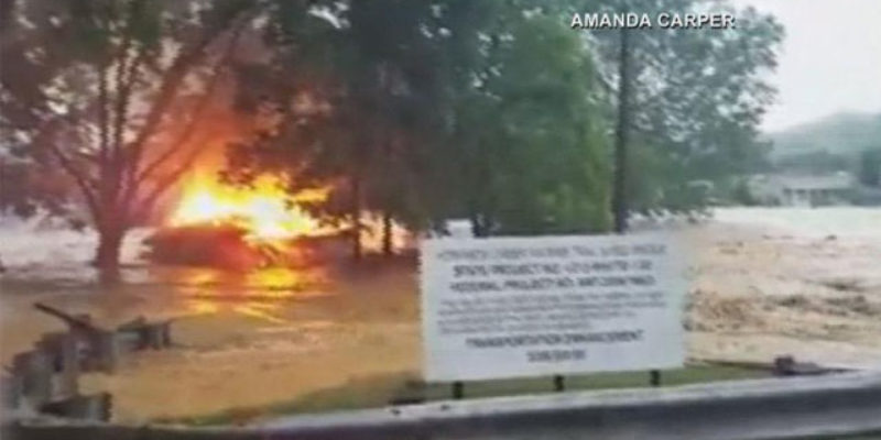 VIDEO: Here's A House, On Fire, Floating Down A Flooded River
