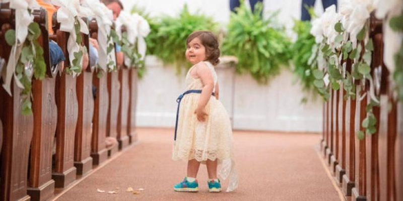 3-year-old cancer survivor serves as flower girl in her bone marrow donor's wedding